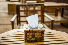 Tissue paper in wooden box holder. Stock Image