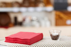 Free Tissue Papers And Glass On Coffee Shop Table Stock Photography - 31227542