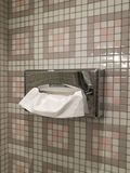 Tissue Stainless box hanging on vintage marble tile wall in toilet at home or hotel with blur bathroom wall background, household Royalty Free Stock Photography