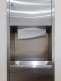 Tissues paper. Soft focus tissues paper towel dispenser on granite wall in barthroom Royalty Free Stock Photos