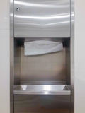 Tissues paper. Soft focus tissues paper towel dispenser on granite wall in barthroom Royalty Free Stock Photography