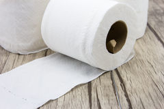 Tissues paper. On wood background Royalty Free Stock Image