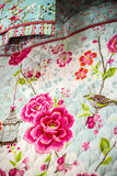 Tissues. In this photo we have two type of tissues, one of them is a quilt. They are decorated with pink roses, birds and leafs. The dominant colors are light Royalty Free Stock Image