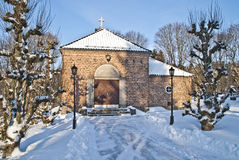 Tistedal chapel. Tistedal chapel, located in the graveyard at Tistedal church, in beautiful winter landscape Stock Image