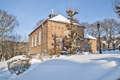 Tistedal chapel. Tistedal chapel, located in the graveyard at Tistedal church, in beautiful winter landscape Royalty Free Stock Image