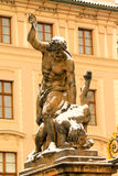 Titan statue at Prague castle entrance. The gate to the first courtyard, called the Courtyard of Honor, by which one enters the castle from Hradcany Square, is royalty free stock photo