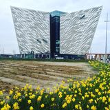 Titanic Museum. Exterior of Titanic Museum with daffodils against cloudy skies stock photography