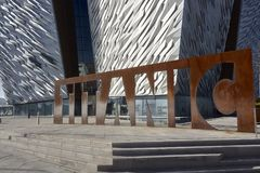 Titanic Museum Entrance Corten Sculpture Belfast. Titanic Museum rusty logo sculpture against wall tile texture Stock Image