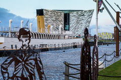 Titanic Museum, SS Nomadic, in Belfast at sunset royalty free stock photography