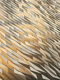Titanic Museum textured wall at sunset. Golden contrasting sharp tiles on the Titanic Museum Belfast Northern Ireland royalty free stock image