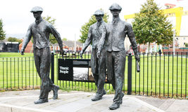 Titanic People statue of Belfast Shipyard workers. This piece of art is on the Newtownards Road Belfast and depicts Belfast shipyard workers from Harland and Stock Image