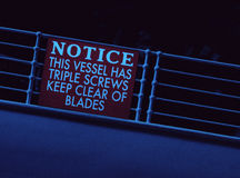 Titanic Sinking Stern Railing Notice sign. The Notice sign attached to the stern railing of the Titanic which would have been one of the last visible sites to Royalty Free Stock Images