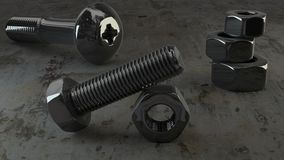 Titanium coated nut and bolt Royalty Free Stock Photos