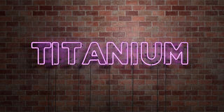 TITANIUM - fluorescent Neon tube Sign on brickwork - Front view - 3D rendered royalty free stock picture Stock Images