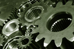 Titanium gear machinery. Large industrial gears of titanium and steel in a machinery concept Royalty Free Stock Photos