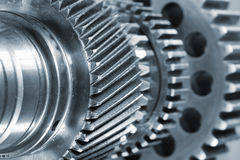 Titanium gear wheels. Aerospace parts, titanium gear wheels and in a blue toning concept Royalty Free Stock Image