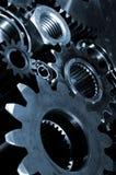 Titanium gears and cogs. Titanium gear wheels, dar blue duplex toning Stock Images