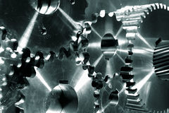 Titanium power gear wheels. Gear wheels and cogs of titanium and in a slight green toning concept Stock Image