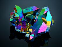 Titanium rainbow aura quartz crystal cluster. A titanium rainbow aura quartz crystal cluster detailed view with sharp focus Royalty Free Stock Images