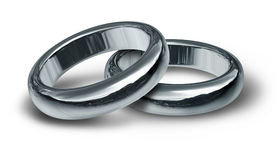 Titanium and silver wedding rings symbol. Titanium and silver titanium wedding rings symbol representing a partnership of trust after a religious ceremony Stock Image