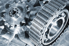 Titanium and steel engineering gears Stock Photography