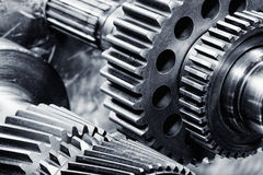 Titanium and steel gears in action Royalty Free Stock Photos