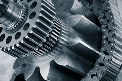 Titanium, steel, industry and machinery. Large gears, cogs and pinion machinery, titanium and steel, blue toning concept Stock Image