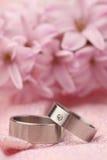Titanium wedding rings. On pink background with hyacinth. Shallow dof Royalty Free Stock Image