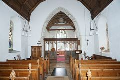 Church Interior. St Mary's church Titchwell which dates from the 11th century. Showing the chancel arch which leads into the alter area Stock Images