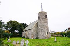 Titchwell Village Church. St Mary's church Titchwell which dates from the 11th century. The tower is an interesting example of the many East Anglian eleventh Stock Photo