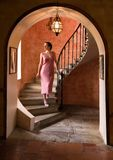 Twenties woman on antique stairs royalty free stock photos