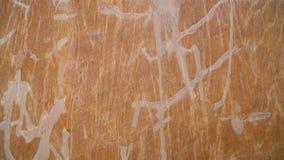 Titel- und Bahrennahaufnahmelangsamneigung UltraHD-Gesamtlänge des orange Schmutzes alte - Hausmauerbeschaffenheitsdetails flach stock video