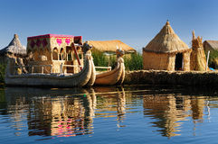 Titicaca lake, Peru, floating islands Uros. Peru, floating Uros islands on the Titicaca lake, the largest highaltitude lake in the world (3808m). Theyre built Stock Images