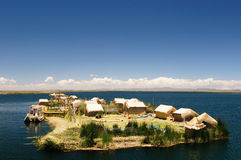 Titicaca lake, Peru, floating islands Uros. Peru, floating Uros islands on the Titicaca lake, the largest highaltitude lake in the world (3808m). Theyre built Stock Photo