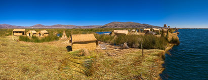 Titicaca lake Peru Uro huts on floating island PANORAMA Stock Photo