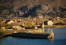 Titicaca Lake Scenics. Reef boats and dwellings on  Uros Island, Titicaca lake Stock Photo