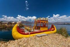 Titicaca Lake Traditional Peruvian Boat. Colorful Traditional Boat On Titicaca Lake on Uros Floating Islands in Peru Stock Photography