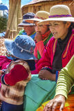 TITICACA, PERU - DEC 29: Indian women peddling her wares on a re Stock Photo