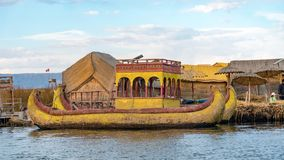 Traditional totora reed boat, Islas es los Uros, Lake Titicaca, Peru. Titicaca, Peru - September 2017: Traditional reed boat as transportation for tourists Royalty Free Stock Photo