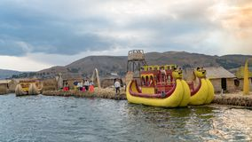 Traditional totora reed boat, Islas es los Uros, Lake Titicaca, Peru. Titicaca, Peru - September 2017: Traditional reed boat as transportation for tourists Stock Photography