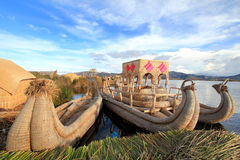 Titicaca's floating islands and boats stock photography