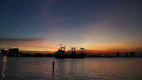Titl shot cargo ship Chao phraya river twilight sky. Titl shot cargo ship at chao phraya river twilight sky stock video