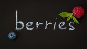Berries in English on the blackboard, flat lay royalty free stock photo