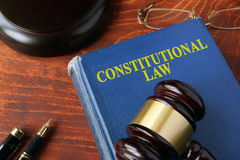 Title constitutional law on a book. And a gavel Stock Photos