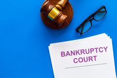 Title of documents the bankruptcy court near judge gavel on blue background top view copy space stock photos