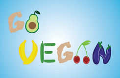 Title go vegan from fruit and vegetables. On blue background Royalty Free Stock Images