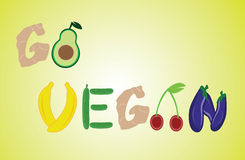Title go vegan from fruit and vegetables. On yellow background Stock Photography