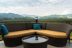 Title lifestyle sofa on the mountain landscape. Outdoor lifestyle sofa on the mountain landscape Royalty Free Stock Images