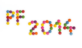 The title PF 2014 written of the colored smarties Royalty Free Stock Photo