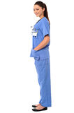 Title:Side pose of a young female doctor in uniform Royalty Free Stock Images